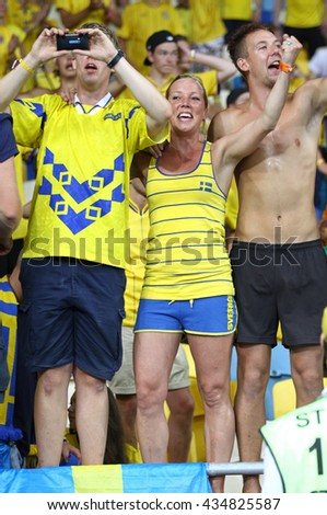 KYIV, UKRAINE - JUNE 19, 2012: Swedish football supporters show their support during UEFA EURO 2012 game against France at NSC Olympic stadium in Kyiv - stock photo