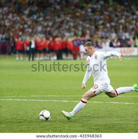 KYIV, UKRAINE - JUNE 24, 2012: Wayne Rooney of England scores a penalty kick during UEFA EURO 2012 Quarter-final game against Italy at Olympic stadium in Kyiv, Ukraine - stock photo