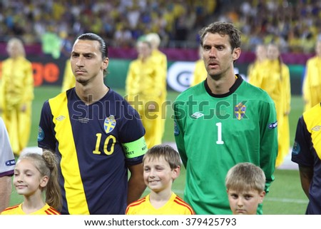 KYIV, UKRAINE - JUNE 11, 2012: Zlatan Ibrahimovic (L) and goalkeeper Andreas Isaksson of Sweden sing the national anthen before UEFA EURO 2012 game against Ukraine at Olympic stadium in Kyiv - stock photo