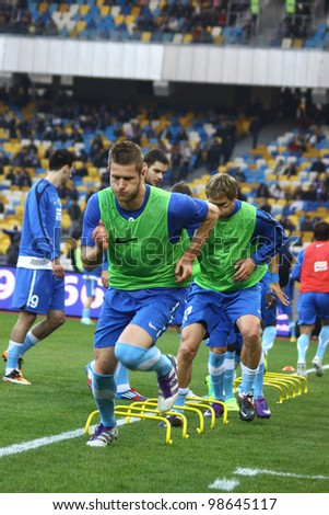 KYIV, UKRAINE - MARCH 18: FC Dnipro players runs during training session before Ukraine Championship game against FC Dynamo Kyiv at NSC Olimpiyskiy stadium on March 18, 2012 in Kyiv, Ukraine - stock photo