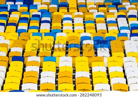 KYIV,UKRAINE-MAY17:Close-up of blue and yellow empty stadium seats during Ukrainian Premier League game between FC Dynamo Kyiv and FC Dnipro Dnipropetrovsk on May 17,2015 in Kyiv,Ukraine - stock photo