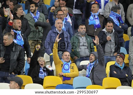 KYIV, UKRAINE - MAY 14, 2015: SSC Napoli supporters show their support during UEFA Europa League semifinal game against Dnipro at NSK Olimpiyskyi stadium in Kyiv - stock photo