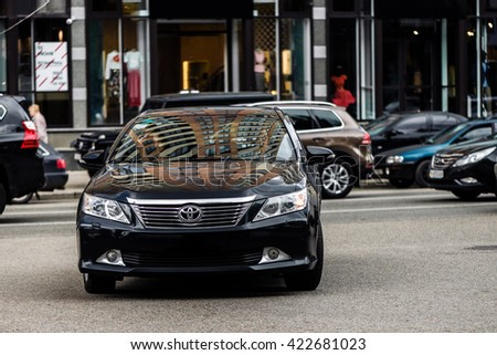 Kyiv, Ukraine - May 18th, 2016: Black motor car Toyota Camry on street. - stock photo
