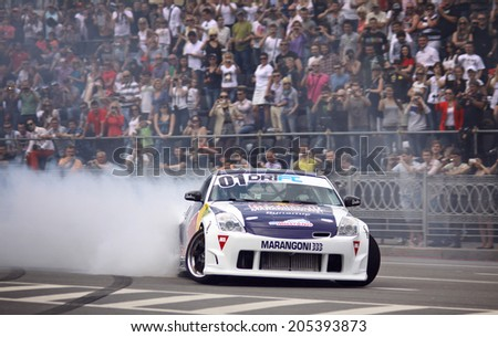 KYIV, UKRAINE - MAY 19, 2012: Ukrainian Drift Champion Alex Grinchuk drives the Nissan 350Z during Red Bull Champions Parade on the streets of Kyiv city - stock photo