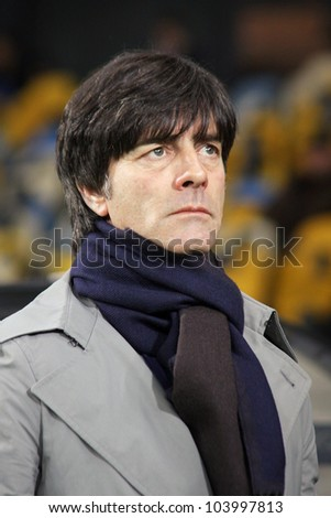 KYIV, UKRAINE - NOVEMBER 11: Germany national team head coach Joachim Low looks on during friendly game against Ukraine at NSK Olimpic stadium on November 11, 2011 in Kyiv, Ukraine - stock photo