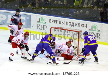 KYIV, UKRAINE - NOVEMBER 11: Poland players (in white) defend their net during ice-hockey pre-olympic qualification game against Ukraine on November 11, 2012 in Kyiv, Ukraine - stock photo