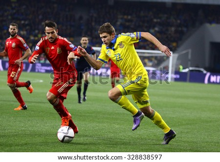 KYIV, UKRAINE - OCTOBER 12, 2015: Artem Kravets of Ukraine (R) fights for a ball with Mario Gaspar of Spain during their UEFA EURO 2016 Qualifying game at NSK Olimpiyskyi stadium in Kyiv - stock photo