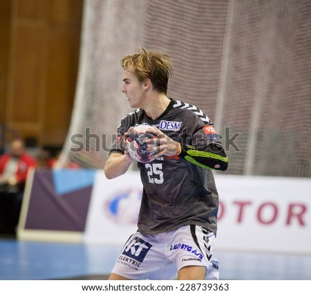 KYIV, UKRAINE - OCTOBER 18, 2014: Christian Jensen of Aalborg controls a ball during European Handball Champions League game against Motor - stock photo