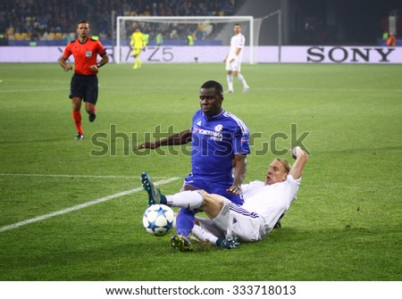 KYIV, UKRAINE - OCTOBER 20, 2015: Domagoj Vida of Dynamo Kyiv (R) fights for a ball with Kurt Zouma of Chelsea during their UEFA Champions League game at NSC Olimpiyskyi stadium in Kyiv - stock photo