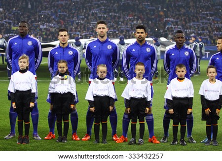 KYIV, UKRAINE - OCTOBER 20, 2015: FC Chelsea players listen official anthem before UEFA Champions League game against FC Dynamo Kyiv at NSC Olimpiyskyi stadium in Kyiv - stock photo