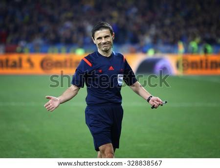 KYIV, UKRAINE - OCTOBER 12, 2015: Referee Milorad Mazic of Serbia in action during UEFA EURO 2016 Qualifying game between Ukraine and Spain at NSK Olimpiyskyi stadium - stock photo