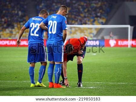 KYIV, UKRAINE - SEPTEMBER 8, 2014: Referee Craig Thomson of Scotland uses the vanishing foam during UEFA EURO 2016 Qualifying game between Ukraine and Slovakia - stock photo