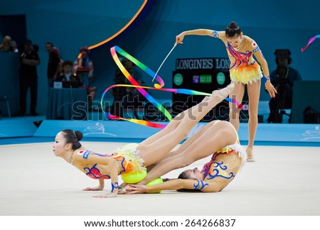 KYIV, UKRAINE - SEPTEMBER 1, 2013: Team of Japan performs during 32nd Rhythmic Gymnastics World Championship (Group Apparatus Final competition) at Palace of Sports in Kyiv - stock photo