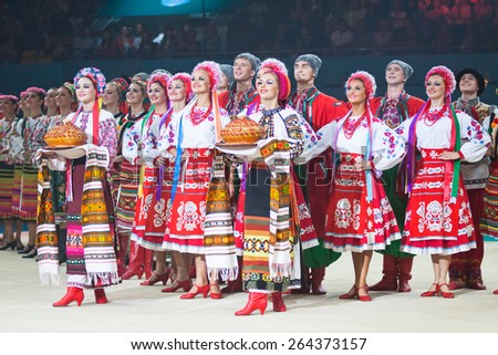 KYIV, UKRAINE - SEPTEMBER 1, 2013: Virsky Ukrainian National Folk Dance Ensemble performs during Gala concert at 32nd Rhythmic Gymnastics World Championship in Kyiv - stock photo