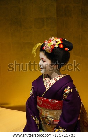 KYOTO - JAN 10: Beautiful unidentified Geisha wearing traditional kimono during a ceremony in Gion district of Kyoto, Japan on January 10, 2010. Geishas are girls skilled in traditional Japanese arts. - stock photo