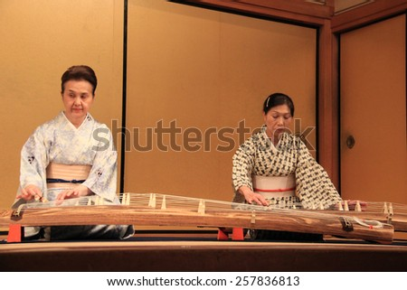 Kyoto, Japan - May 27, 2013: Japanese women are performing koto, a traditional Japanese stringed musical instrument. - stock photo