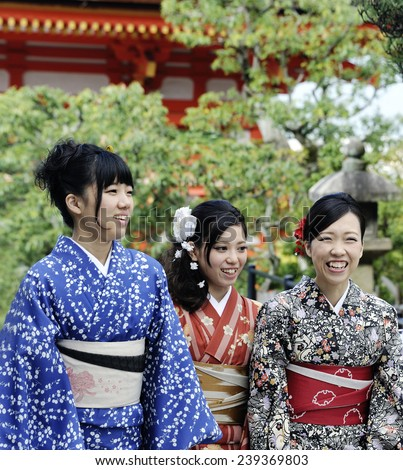 """KYOTO, JAPAN-NOVEMBER 4, 2014;A group of """"one day geisha"""" Japanese girls,walking in a temple complex.November 4, 2014 Kyoto,Japan - stock photo"""