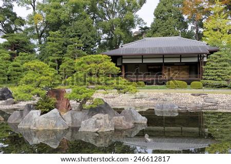 KYOTO, JAPAN-NOVEMBER 8, 2014; Ninomaru Palace at Nijo Castle extends the Ninomaru Garden a traditional Japanese landscape garden with a large pond and ornamental stones.November 8, 2014, Kyoto, Japan - stock photo