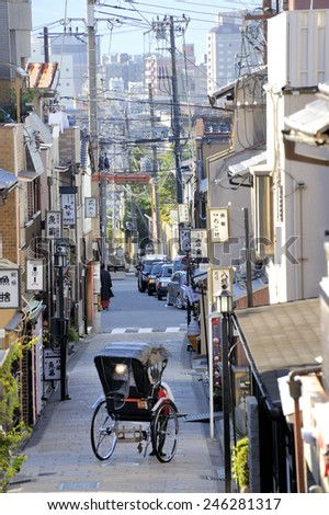 KYOTO, JAPAN - NOVEMBER 4, 2014: Street in the old part of the city. Old Kyoto is an UNESCO World Heritage site.November 4, 2014 Kyoto, Japan - stock photo