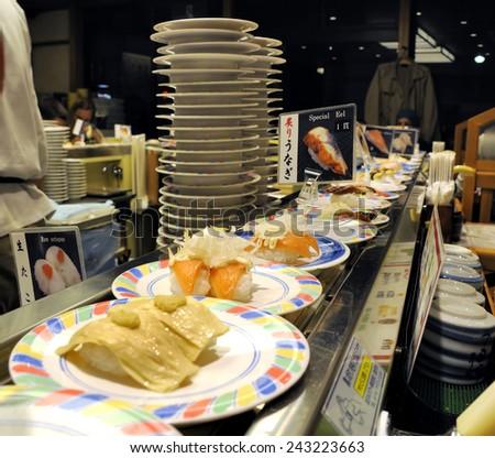 KYOTO, JAPAN-NOVEMBER 5, 2014; sushi at a conveyor belt at a cheap sushi restaurant. November 5, 2014 Kyoto, Japan - stock photo