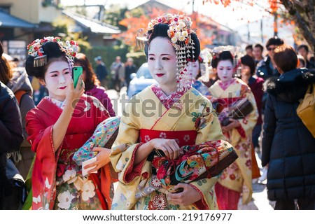 KYOTO,JAPAN - November 23, 2013 :Traditional geishas are walking on the street In Arashiyama , Kyoto, Japan on November 23, 2013. - stock photo
