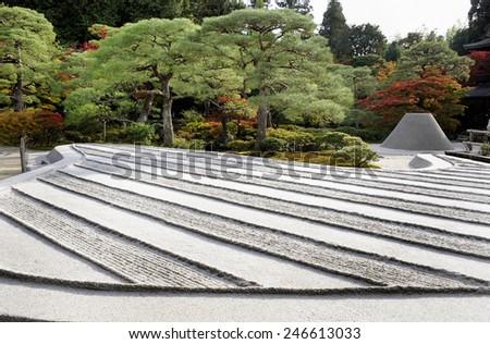KYOTO, JAPAN-NOVEMBER 10, 2014; Zen garden with sand tower named Kogetsudai, representing fuji montain.November 10, 2014, Kyoto, Japan  - stock photo