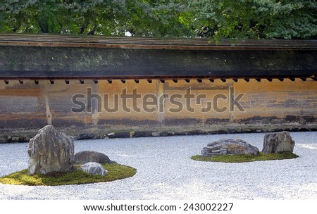 KYOTO, JAPAN-NOVEMBER 10, 2014;Zen Rock Garden in Ryoanji Temple.In a garden there are fifteen stones on white gravel. November 10, 2014 Kyoto,Japan - stock photo