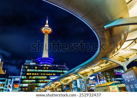KYOTO, JAPAN - OCTOBER 22: Kyoto Tower in Kyoto, Japan on October 22, 2014. Completed in 1964, the tallest structure in Kyoto stands atop a 9-story building, located opposite Kyoto Station - stock photo