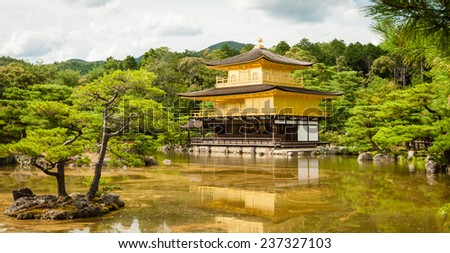 KYOTO, JAPAN - SEPTEMBER 9, 2012: Kinkaku-ji temple in colorful landscape, Kyoto, Japan - stock photo