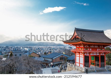 Kyoto, Japan - September 1, 2009: View of the Nio-mon Gate (in the right) and a distant view of Kyoto City from the West gate at sunset. Japanese people and tourists visiting the Temple.  - stock photo