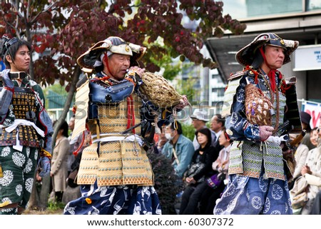 KYOTO - OCT 22: Participants at The Jidai Matsuri (Festival of the Ages) held on October 22, 2009 in Kyoto, Japan. It is one of Kyoto's renowned three great festivals. - stock photo