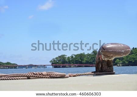 L-type bitt, poller, bollard at a harbor pier - stock photo