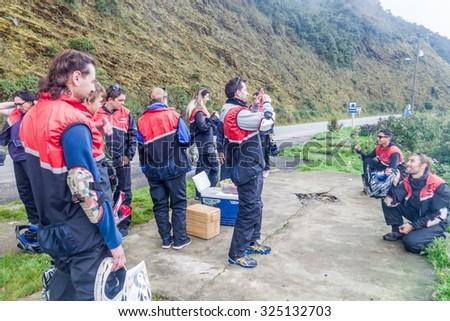 LA CUMBRE, BOLIVIA: APRIL 29, 2015: Participants of the descent of The World's most dangerous road at La Cumbre pass (altitude 4700 m) in Bolivia. - stock photo