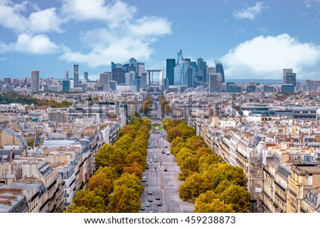 La Defense Financial District Paris France in autumn. Traffic on Champs-Elysees with orange and yellow trees aside. Modern vs. Old architecture - stock photo