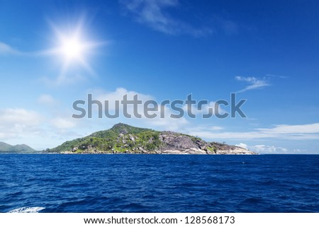 La Digue island, Seychelles. The island of dreams for a rest and relaxation. White coral beach sand. A heavenly place. - stock photo