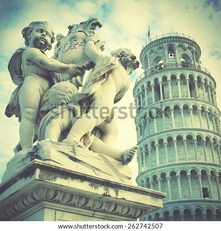 La Fontana dei Putti Statue and Leaning Tower of Pisa, Italy. Instagram style filtred image - stock photo