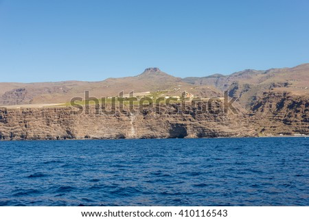 La Fortaleza on La Gomera. The mountain is a huge volcanic plug on the west side of the island. In the foreground the steep coast of the village La Dama known for agriculture and banana plantation  - stock photo