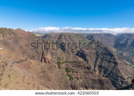 La Gomera. Trail over the Barranco de Arure. The Barranco de Arure is a side valley from the Valle Gran Rey. The long distance trail to the village Arure leads over the left altitude of the ravine - stock photo