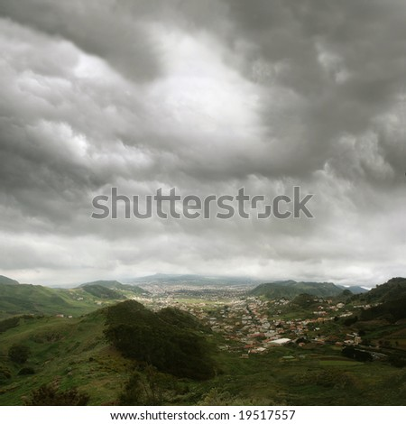 La Laguna, the university city of Tenerife, Spain. Seen from the Anaga mountains under deep gray passat clouds - stock photo