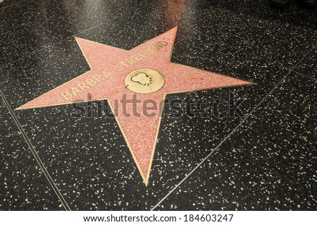 LA - MARCH 29: Hollywood Walk of Fame on March 29, 2014 in LA. The Hollywood Walk of Fame has over 2,500 five-pointed stars embedded in 15 blocks of sidewalk of Hollywood Boulevard. - stock photo