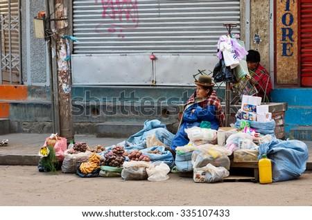 La Paz, Bolivia-Apr 05, 2015: Bolivian woman sells vegetables on the street market in La Paz - stock photo