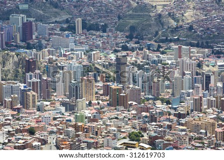 LA PAZ, BOLIVIA, JANUARY 4: Aerial view of La Paz during the day, capital of Bolivia. Downtown of the city with a lot of residential buildings. Bolivia 2015 - stock photo