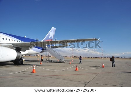 LA PAZ, BOLIVIA - SEPTEMBER 3, 2010:The actual capital of Bolivia, where most of the state institutions and the residence of the President of the country. Aircraft at the airport of La Paz. - stock photo