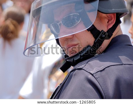 LA Police in riot gear watches over demonstrators at illegal emigrant rally. May 1st 2006 - stock photo