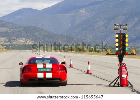 LA SEU D'URGELL, SPAIN - OCTOBER 7: A Dodge Viper SRT take part in Road and Track racing weekend organized by American Car Club, on October 7, 2012, in the airport of La Seu d'Urgell, Spain. - stock photo