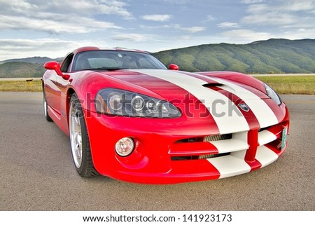 LA SEU D'URGELL, SPAIN - OCTOBER 6: A Dodge Viper SRT take part in Road and Track racing weekend organized by American Car Club, on October 6, 2012, in the airport of La Seu d'Urgell, Spain. - stock photo