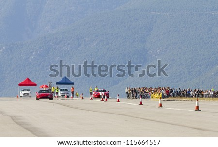 LA SEU D'URGELL, SPAIN - OCTOBER 7: Some cars take part in Road and Track racing weekend organized by American Car Club, on October 7, 2012, in the airport of La Seu d'Urgell, Spain. - stock photo