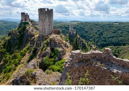 La Tour Regine Surdespine and Quertinheux towers at Lastours in France - stock photo