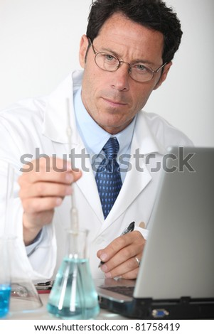 Lab technician analyzing test results - stock photo