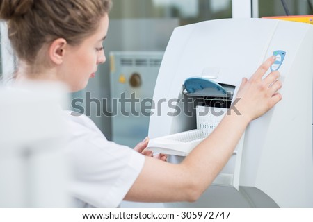 Lab technician using modern equipment in laboratory - stock photo